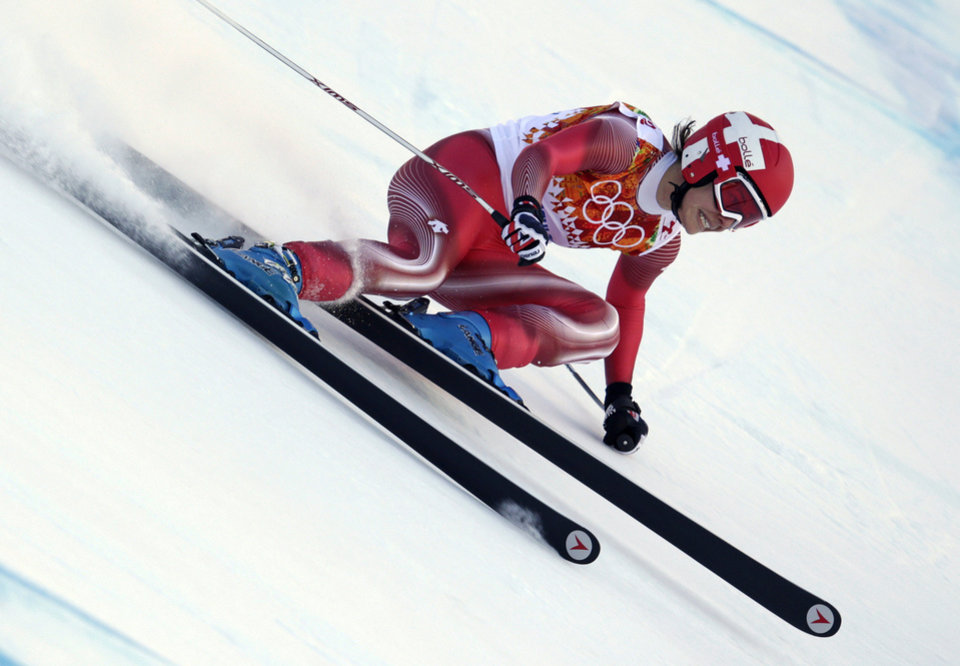 Photo - Switzerland's Dominique Gisin makes a turn in the women's downhill at the Sochi 2014 Winter Olympics, Wednesday, Feb. 12, 2014, in Krasnaya Polyana, Russia. (AP Photo/Charles Krupa)