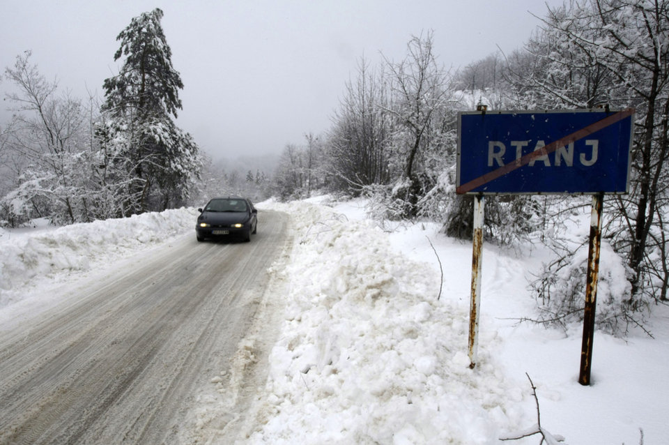 "A car past a traffic sign saying ""Rtanj"" in the Serbian mountain of Rtanj, some 220km (140 miles) southeast of Belgrade, Serbia, Friday, Dec. 21, 2012. Though the Mayans never predicted outright that the world would end Friday, some New Agers are convinced that the apocalypse is indeed coming Dec. 21, 2012, the supposed end of a 5,125-year Mayan calendar. While descendants of the ancient Mayans in Mexico are facing the date with a calm conviction that life will go on, a frenzy has gripped others across the world, drawing them to several spots said to promise survival. Mayan doomsday cultists are flocking to Mount Rtanj, a pyramidal peak in Serbia, which they believe may have the power to save them on December 21.(AP Photo/Darko Vojinovic)"
