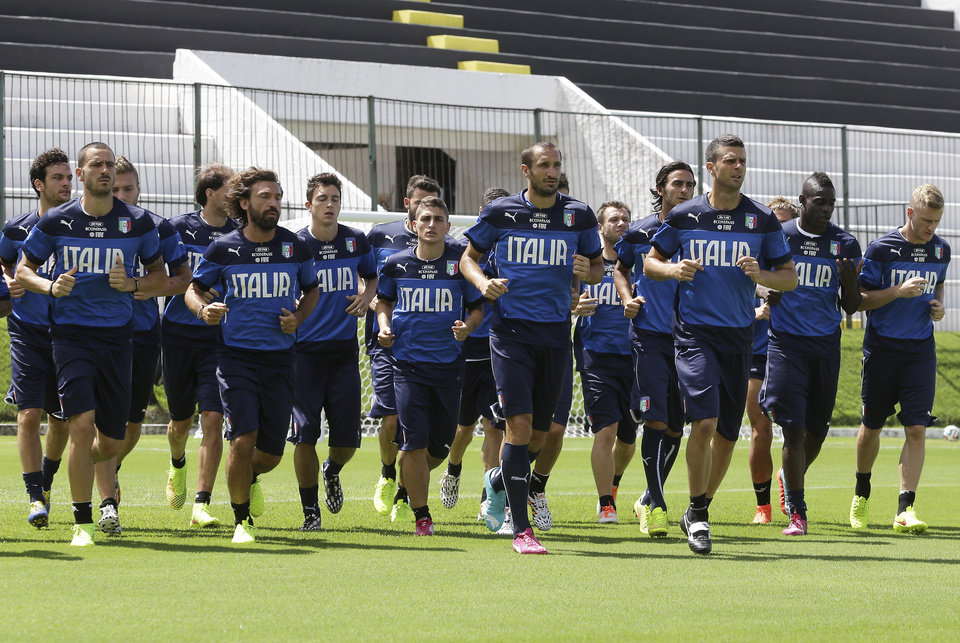 Photo - Italy players run laps during a training session at the Maria Lamas Farache Stadium in Natal, Brazil, Sunday, June 22, 2014. Italy plays in group D of the Brazil 2014 soccer World Cup. (AP Photo/Antonio Calanni)