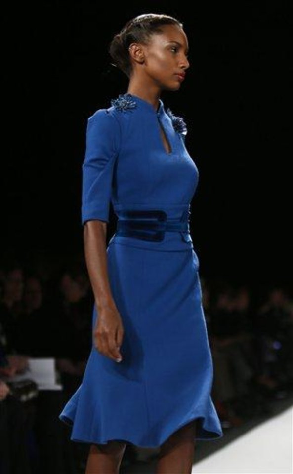 Fashion from the Fall 2013 collection of Carolina Herrera is modeled on Monday, Feb. 11, 2013 in New York.  (AP Photo/Bebeto Matthews)