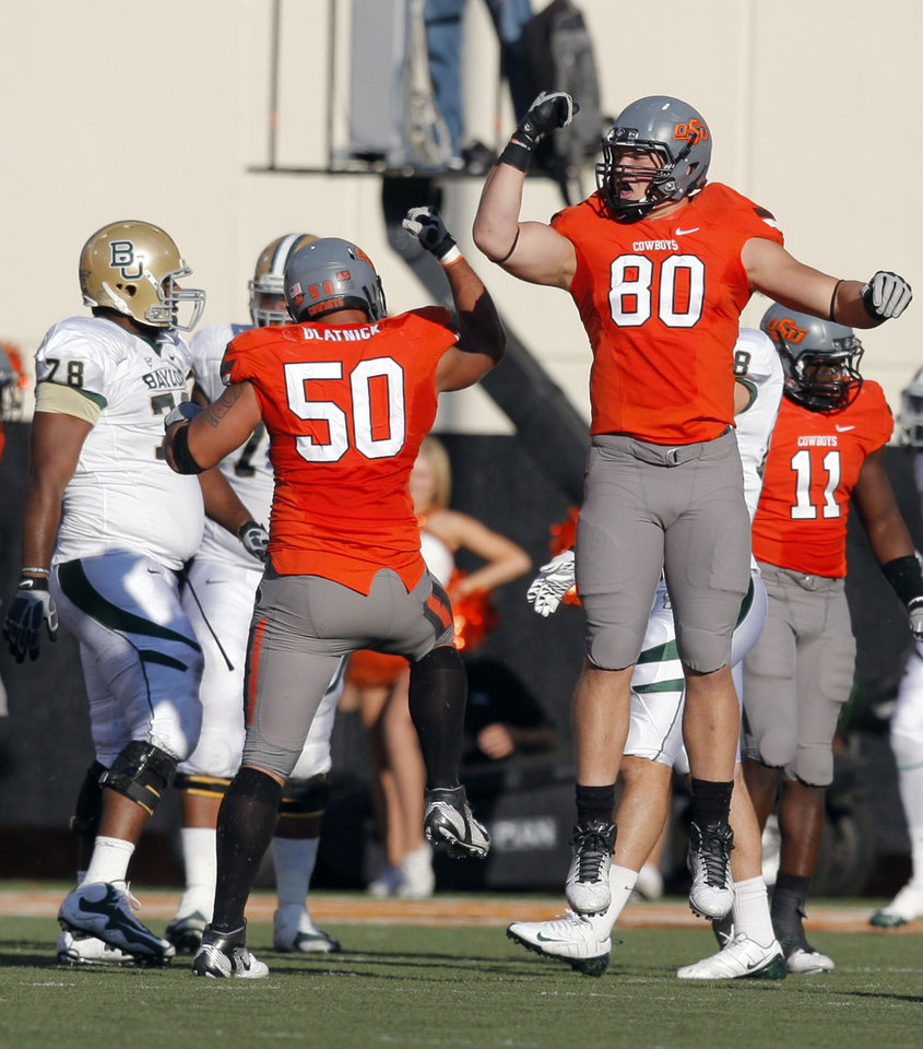 Photo - Oklahoma State's Cooper Bassett (80) and Jamie Blatnick (50) celebrate a sack during a college football game between the Oklahoma State University Cowboys (OSU) and the Baylor University Bears (BU) at Boone Pickens Stadium in Stillwater, Okla., Saturday, Oct. 29, 2011. Photo by Sarah Phipps, The Oklahoman
