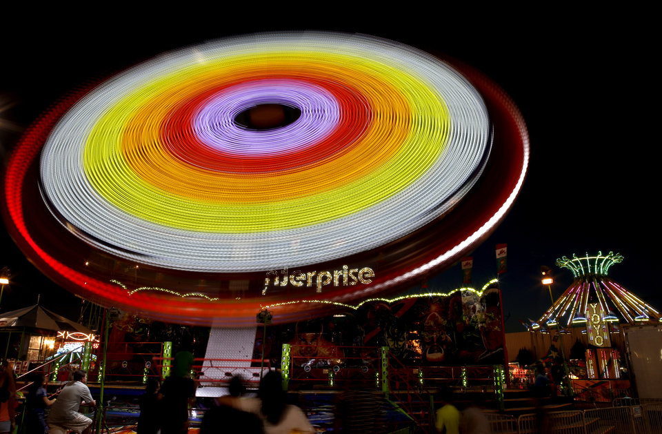 Visitors to the Oklahoma State Fair enjoy a ride on the midway in Oklahoma City, Wednesday, Sept. 18, 2013. Photo by Bryan Terry, The Oklahoman