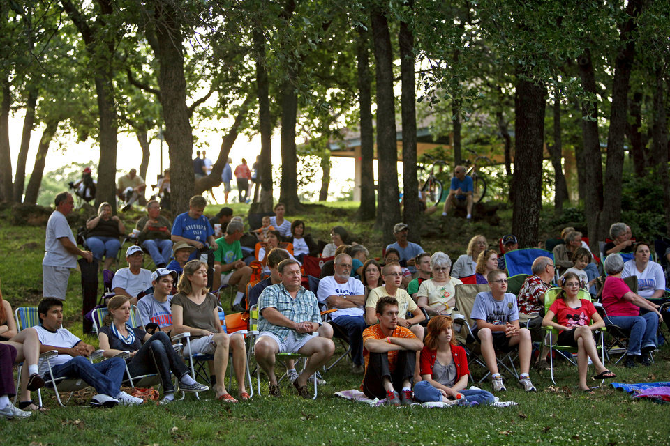 Photo - A crowd listens to Souled Out during the 2012 Edmond Summer Concert Series at E.C. Hafer Park on Thursday.  BRYAN TERRY - THE OKLAHOMAN