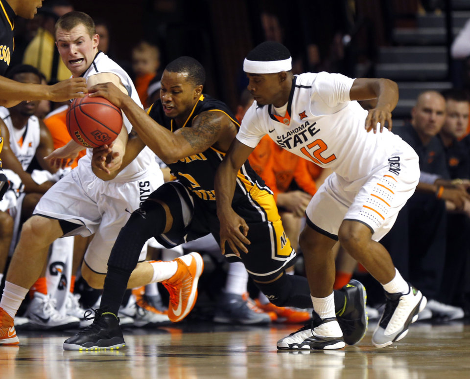 Photo - Oklahoma State's Phil Forte III (13) and Anthony Hickey Jr. (12) defend against Missouri Western's Aaron Emmanuel during the men's college between Oklahoma State University and Missouri Western at Gallagher-Iba Arena in Stillwater, Okla., Saturday, Nov. 8, 2014.  Photo by Sarah Phipps, The Oklahoman