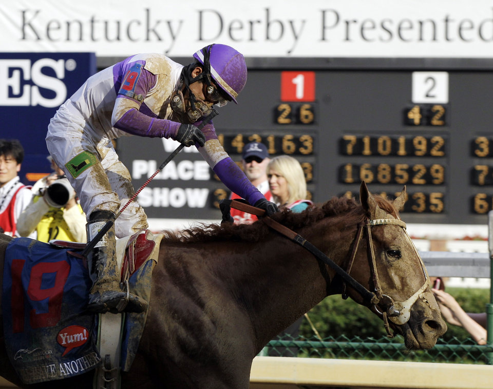 Photo - Jockey Mario Gutierrez rides I'll Have Another to victory in the 138th Kentucky Derby horse race at Churchill Downs Saturday, May 5, 2012, in Louisville, Ky. (AP Photo/Mark Humphrey)  ORG XMIT: DBY180