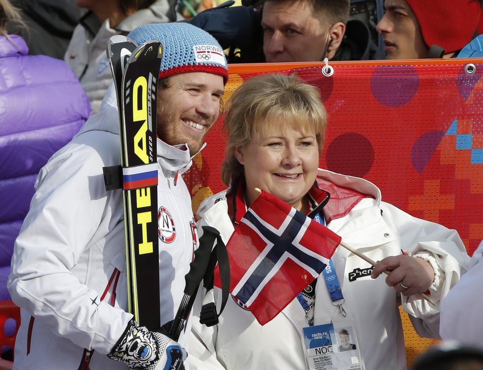 Photo - Norway's Kjetil Jansrud poses for a photograph with the Norwegian Erna Solberg after his finish in the men's super-G at the Sochi 2014 Winter Olympics, Sunday, Feb. 16, 2014, in Krasnaya Polyana, Russia. (AP Photo/Christophe Ena)