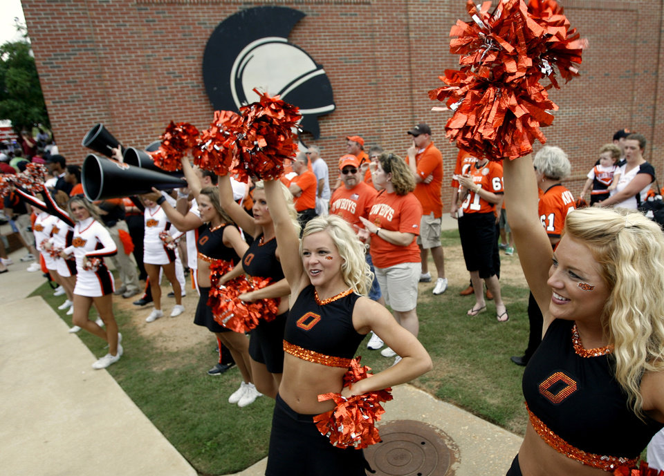 Photo - Members of the OSU Spirit Squad cheer during a pep rally before the college football game between the Troy University Trojans and the Oklahoma State University Cowboys at Movie Gallery Veterans Stadium in Troy, Ala., Friday, September 14, 2007. BY MATT STRASEN, THE OKLAHOMAN