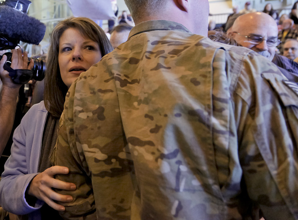 Kristy Brock looks for her second son Justin Farrow during the return ceremony for more than 200 National Guard 45th Infantry Brigade Combat Team troops at the National Guard Base on Monday, March 12, 2012, in Oklahoma City, Oklahoma.  Photo by Chris Landsberger, The Oklahoman