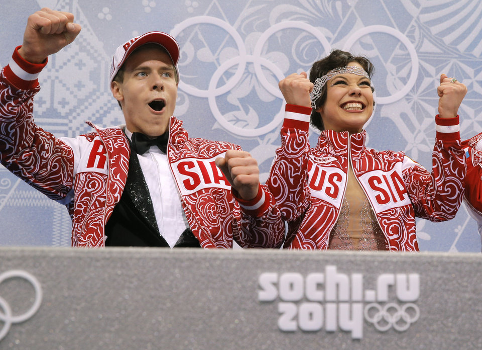 Photo - Elena Ilinykh and Nikita Katsalapov of Russia react in the results area after competing in the ice dance short dance figure skating competition at the Iceberg Skating Palace during the 2014 Winter Olympics, Sunday, Feb. 16, 2014, in Sochi, Russia. (AP Photo/Vadim Ghirda)