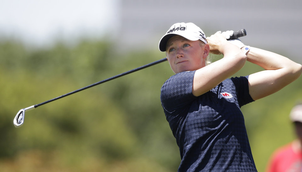 Photo - Stacy Lewis watches her tee shot on the 11th hole during the third round of the North Texas LPGA Shootout golf tournament at Las Colinas Country Club in Irving, Texas, Saturday, May 3, 2014. (AP Photo/LM Otero)