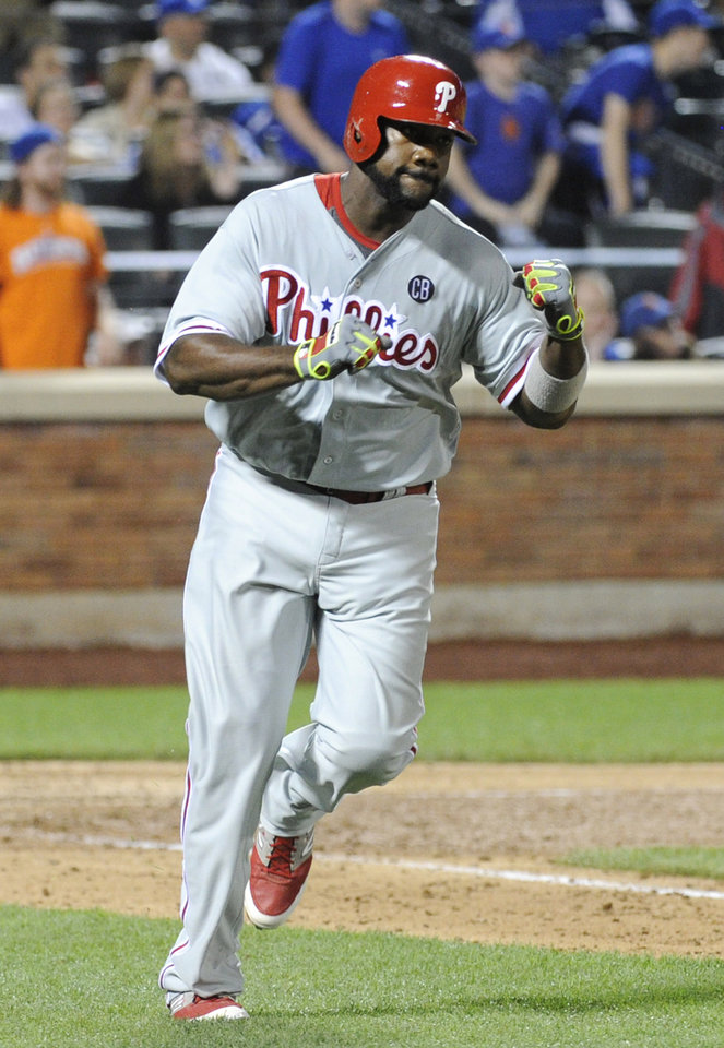 Photo - Philadelphia Phillies' Ryan Howard reacts after hitting an RBI-single during the ninth inning of a baseball game against the New York Mets, Saturday, May 10, 2014, at Citi Field in New York. The Phillies defeated the Mets 5-4. (AP Photo/Bill Kostroun)
