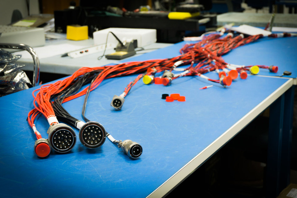 Photo -  Wire assemblies for an aviation project are being constructed.