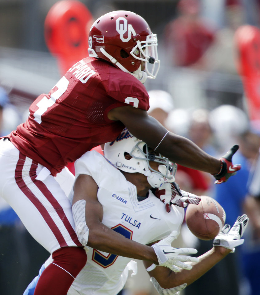 Photo - Oklahoma's Sterling Shepard (3) and Tulsa's Dwight Dobbins (9) fight for a pass during a college football game between the University of Oklahoma Sooners (OU) and the Tulsa Golden Hurricane (TU) at Gaylord Family-Oklahoma Memorial Stadium in Norman, Okla., on Saturday, Sept. 14, 2013. Photo by Steve Sisney, The Oklahoman