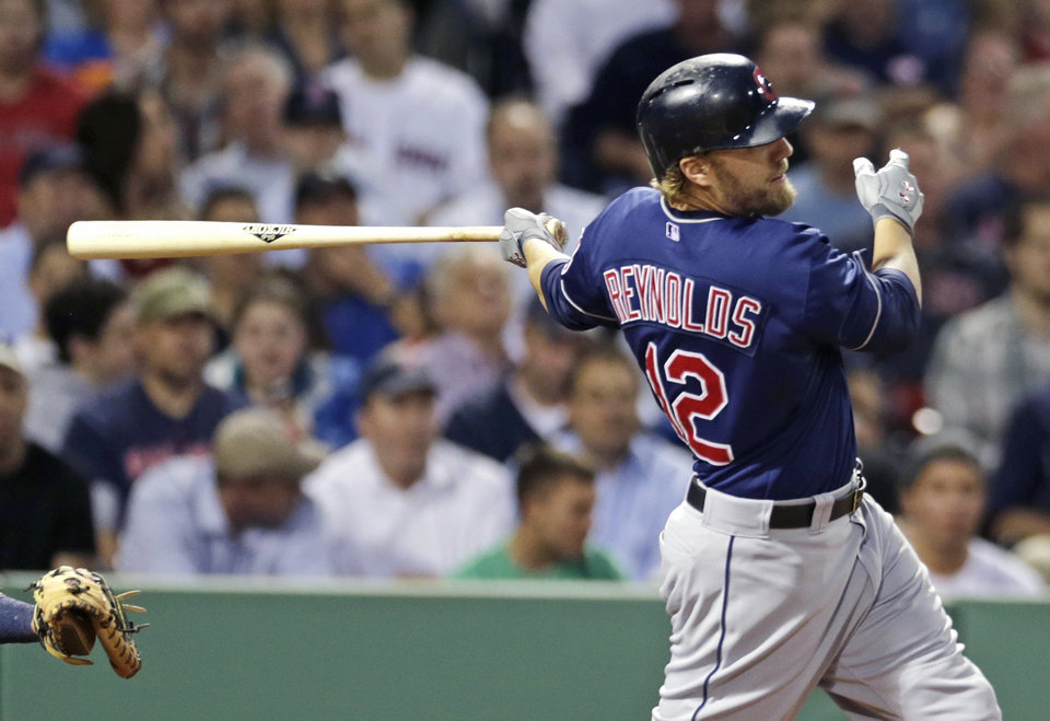 Photo - Cleveland Indians' Mark Reynolds follows through on a two-run single during the third inning of a baseball game against the Boston Red Sox at Fenway Park in Boston, Thursday, May 23, 2013. (AP Photo/Charles Krupa)
