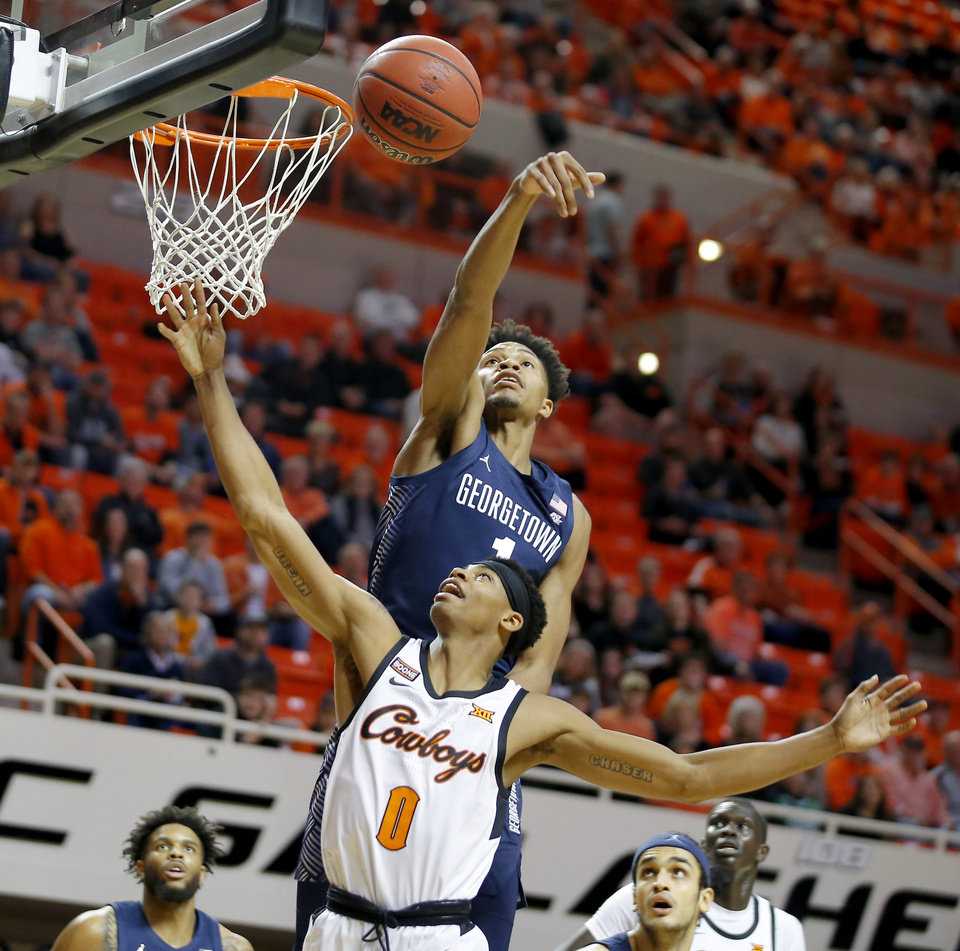 Photo - Georgetown's Jamorko Pickett (1) blocks the shot of Oklahoma State's Avery Anderson III (0) during a college basketball game between the Oklahoma State University Cowboys (OSU) and the Georgetown Hoyas at Gallagher-Iba Arena in Stillwater, Okla., Wednesday, Dec. 4, 2019. [Bryan Terry/The Oklahoman]