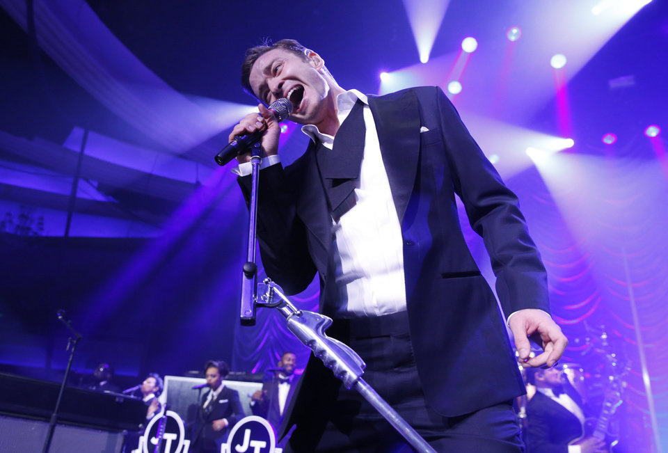 Photo - FILE - In this Sunday, Feb. 10, 2013, file photo, Justin Timberlake performs at his Post Grammy Concert at the Palladium, in Los Angeles. Newcomers Macklemore & Ryan Lewis will battle heavyweights Timberlake and Taylor Swift for the top prize at the 2013 American Music Awards. (Photo by Todd Williamson/Invision/AP, File)