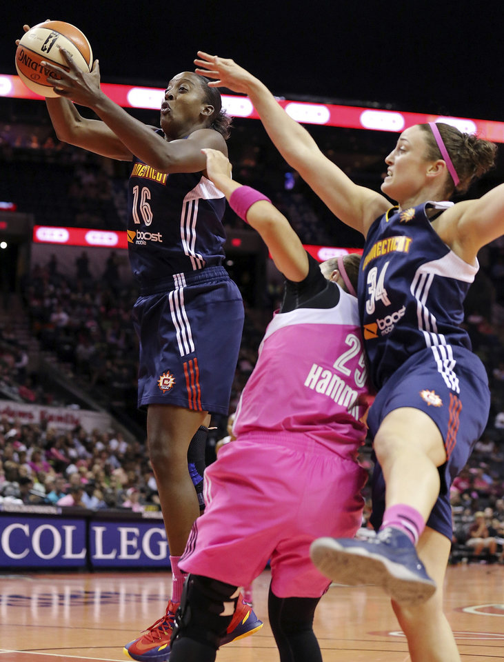 Photo - Connecticut Sun's Ebony Hoffman, left, and Kelly Faris grab for a rebound over San Antonio Stars' Becky Hammon during the first half of a WNBA basketball game, Friday Aug. 1, 2014 at the AT&T Center in San Antonio. (AP Photo/The San Antonio Express-News, Edward A. Ornelas)  RUMBO DE SAN ANTONIO OUT; NO SALES