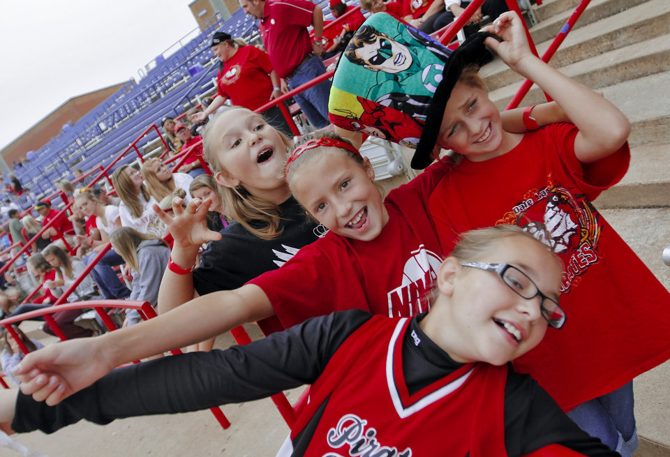 HIGH SCHOOL SOFTBALL TOURNAMENT: Dale High School fans Kate Collins, Elaine Witt, Kaitlyn Wilson and Jordyn Powell, from left, have fun in the stands during the Oklahoma State Softball tournament game between Wayne and Dale at ASA Hall of Fame Stadium on Thursday, Oct. 4, 2012, in Oklahoma City, Okla.   Photo by Chris Landsberger, The Oklahoman