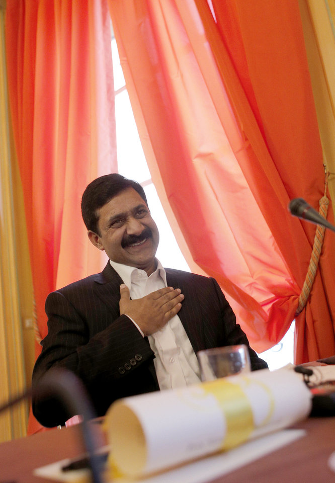 Ziauddin Yousufzai gestures before receiving, on behalf of his daughter Malala Yousufzai, the Simone de Beauvoir Prize for Women's Freedom, in Paris, Wednesday, Jan. 9, 2013. Malala Yousafzai, who is currently living in the UK, was the victim of an assassination attempt in October last year because of her determined commitment to the right to education. (AP Photo/Christophe Ena)