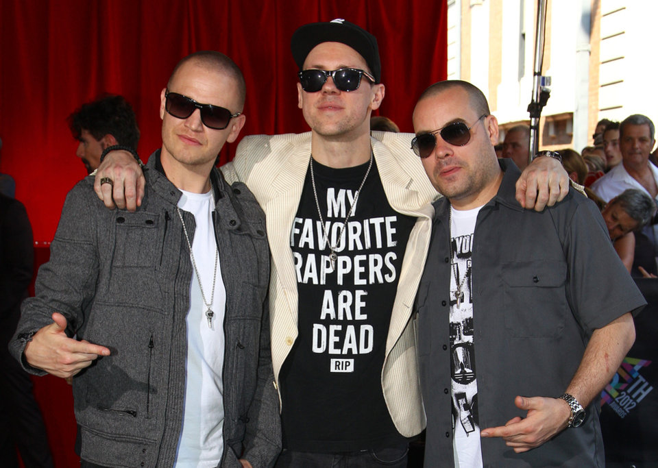 The Hilltop Hoods members, from left, Daniel Smith, Matt Lambert and Barry Francis, pose for photographers upon arrival for the Australian music industry Aria Awards in Sydney, Thursday, Nov. 29, 2012. (AP Photo/Rick Rycroft)