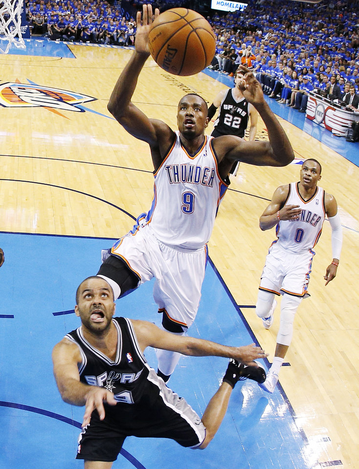 Photo - Oklahoma City's Serge Ibaka (9) goes up to block the shot of San Antonio's Tony Parker (9) during Game 3 of the Western Conference Finals in the NBA playoffs between the Oklahoma City Thunder and the San Antonio Spurs at Chesapeake Energy Arena in Oklahoma City, Sunday, May 25, 2014. Photo by Nate Billings, The Oklahoman