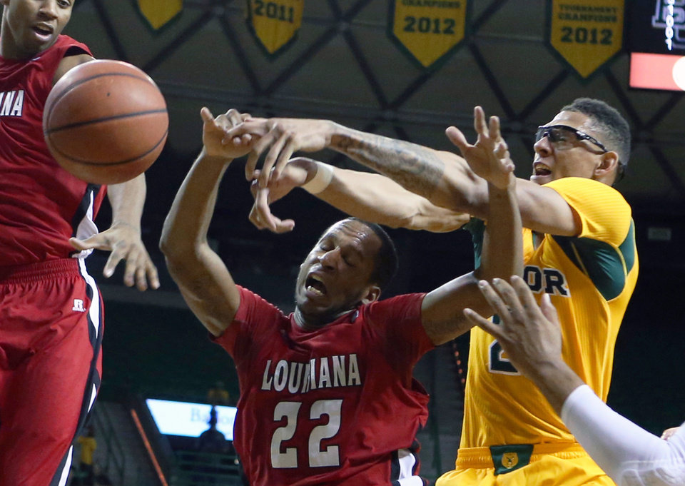 Louisiana Lafayette forward Elridge Moore (22) battles Baylor forward Cory Jefferson (34), right, for a loose ball in the first half of an NCAA college basketball game, Sunday, Nov. 17, 2013, in Waco, Texas. (AP Photo/Waco Tribune Herald, Rod Aydelotte)