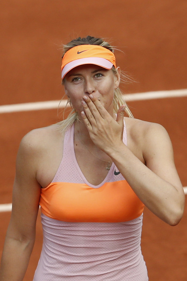 Photo - Russia's Maria Sharapova blows a kiss to spectators after winning her third round match of the French Open tennis tournament against Argentina's Paula Ormaechea at the Roland Garros stadium, in Paris, France, Friday, May 30, 2014. Sharapova won in two sets 6-0, 6-0. (AP Photo/Darko Vojinovic)