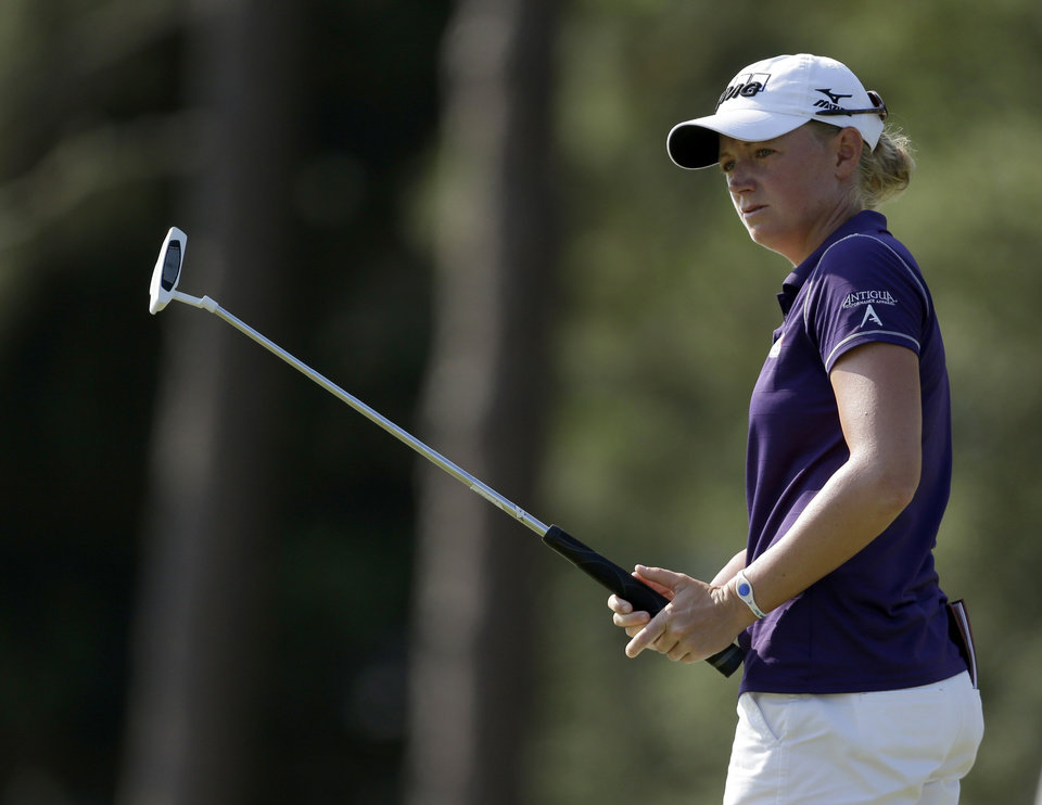 Photo - Stacy Lewis watches her putt on the 13th hole during the first round of the U.S. Women's Open golf tournament in Pinehurst, N.C., Thursday, June 19, 2014. (AP Photo/Bob Leverone)