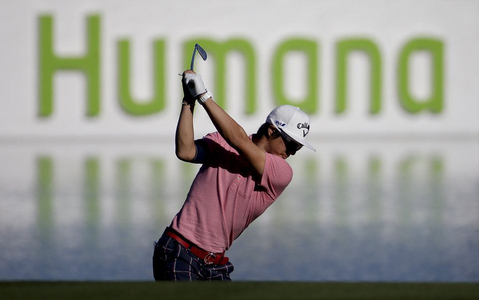 Photo - Ryo Ishikawa hits to the 18th green during the pro-am portion of the Humana Challenge Golf tournament on the Palmer Private course at PGA West, Wednesday, Jan. 15, 2014 in La Quinta, Calif. (AP Photo/Chris Carlson)