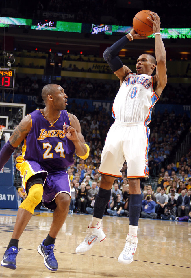 Photo - Oklahoma City's Russell Westbrook (0) shoots as Lakers' Kobe Bryant (24) defends during the NBA basketball game between the Oklahoma City Thunder and the Los Angeles Lakers, Sunday, Feb. 27, 2011, at the Oklahoma City Arena.Photo by Sarah Phipps, The Oklahoman  ORG XMIT: KOD