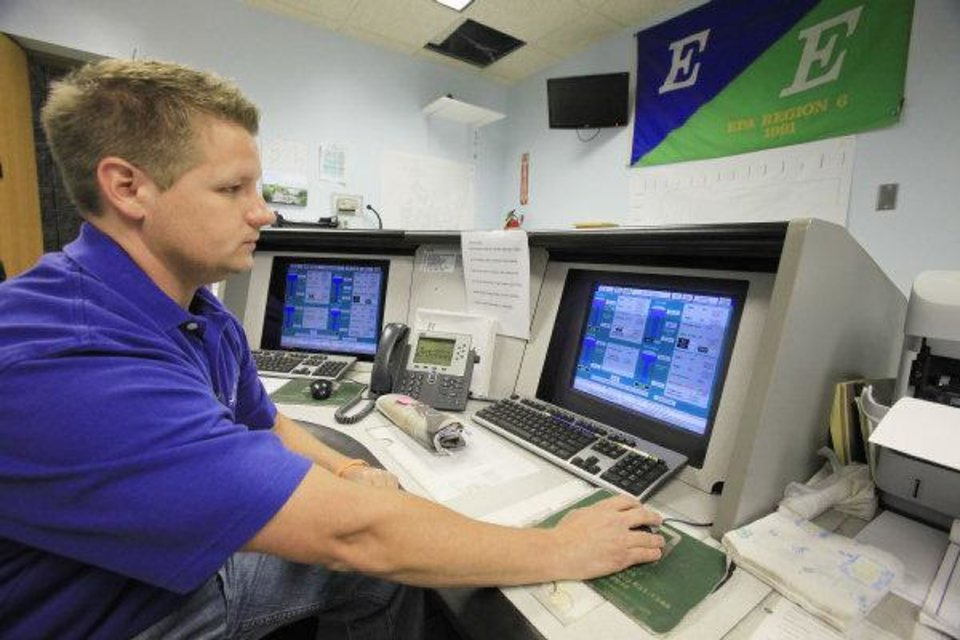 George Decher, the state's 2010 water lab technician of the year, works with computer equipment at the the Edmond water treatment plant's control center. Building and expanding water treatment and distribution systems are expected to be a major cost to Oklahomans over the next five decades. <strong>David McDaniel - THE OKLAHOMAN</strong>