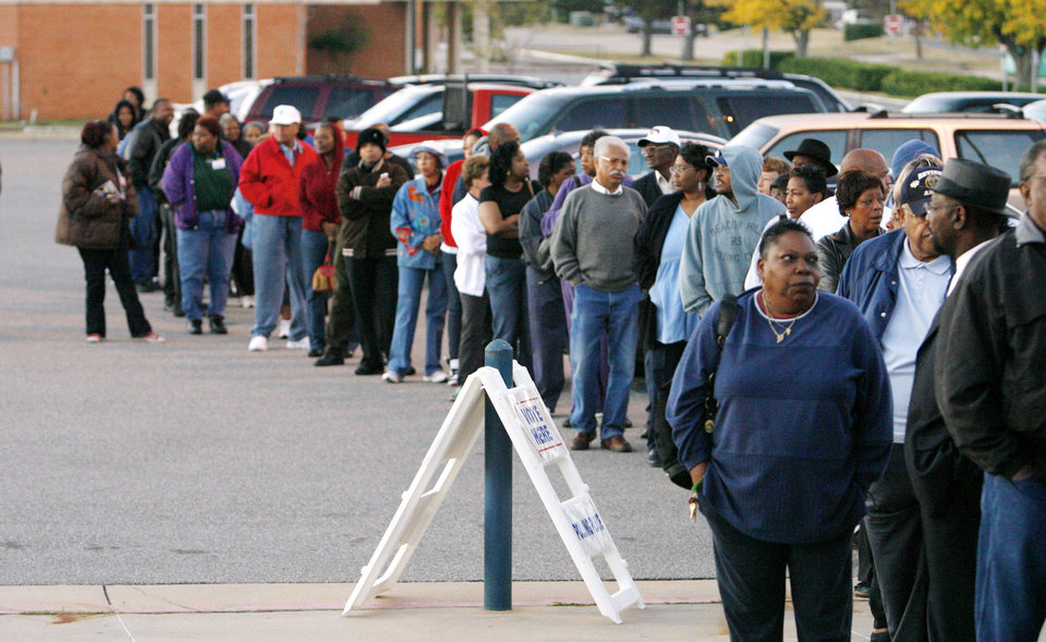 Photo - Voters line up before the sun rises as they wait for precinct 551 to open to vote at Millwood High School in Oklahoma City Tuesday, Nov. 4, 2008. BY PAUL B. SOUTHERLAND, THE OKLAHOMAN