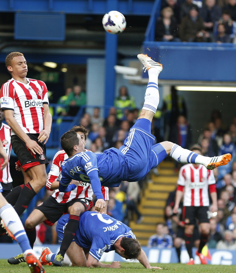 Photo - FILE - In this Saturday, April 19, 2014 file photo Chelsea's Fernando Torres, center, takes a shot during the English Premier League soccer match against Sunderland at the Stamford Bridge ground in London. Chelsea said Friday, Aug. 29, 2014 t has agreed terms with AC Milan for striker Fernando Torres to join the Serie A club in a two-year loan deal. The Premier League club said in a statement that