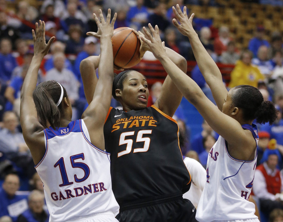 Photo - Oklahoma State center LaShawn Jones (55) handles the ball while covered by Kansas forward Chelsea Gardner (15) and guard CeCe Harper (24) during the first half of an NCAA college basketball game in Lawrence, Kan., Wednesday, Jan. 22, 2014. (AP Photo/Orlin Wagner)