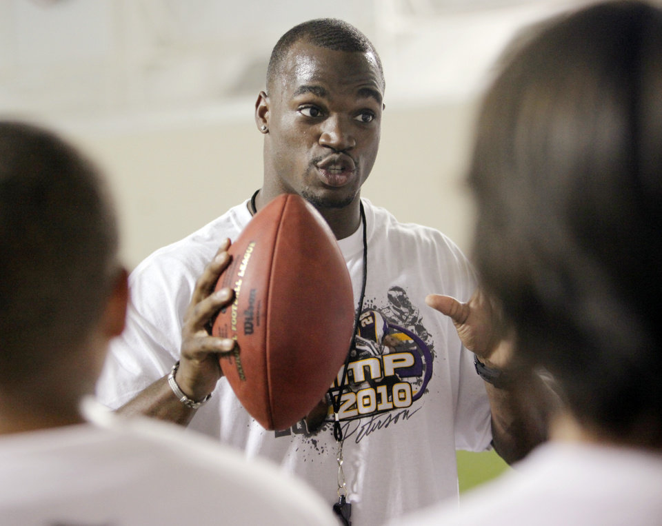 Photo - Adrian Peterson gives instructions during a football camp at OU's Everest Training Center in Norman, Okla., Friday, July 23, 2010. Peterson, an NFL running back and former player for the University of Oklahoma, gave the camp for at-risk youth from the Seeworth Academy. Photo by Nate Billings, The Oklahoman