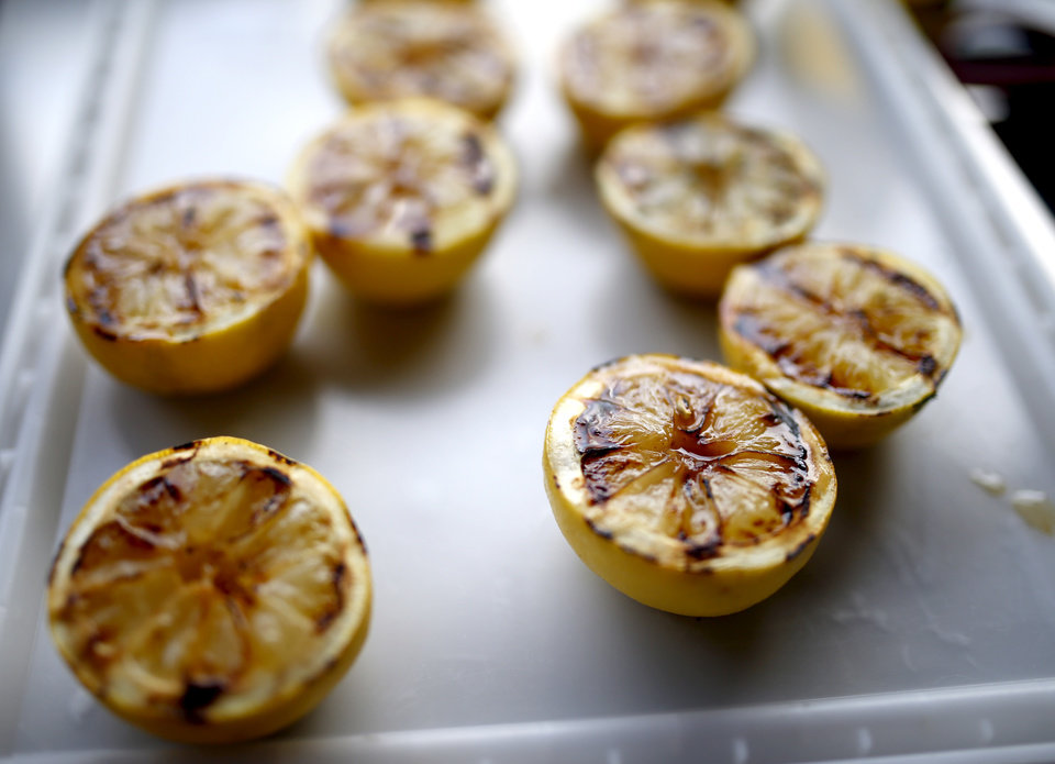Photo -  Grilled lemons. Photo by Sarah Phipps, The Oklahoman   SARAH PHIPPS -  SARAH PHIPPS