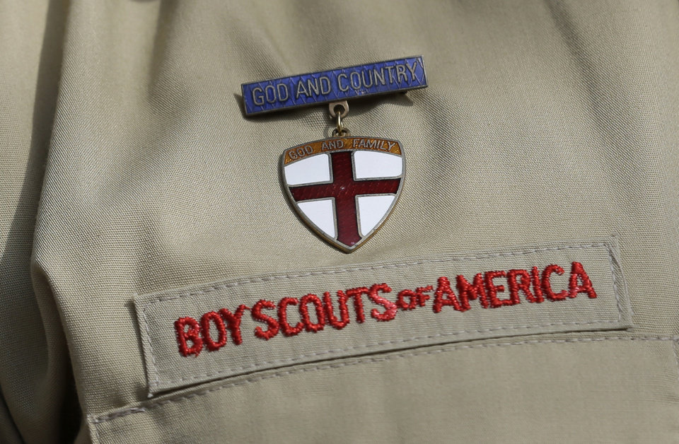 This photo taken Monday, Feb. 4, 2013, shows a close up detail of a Boy Scout uniform worn by Brad Hankins, a campaign director for Scouts for Equality, as he responds questions during a news conference in front of the Boy Scouts of America headquarters in Irving, Texas. The Boy Scouts of America\'s policy excluding gay members and leaders could be up for a vote as soon as Wednesday, when the organization\'s national executive board meets behind closed doors under intense pressure from several sides. (AP Photo/Tony Gutierrez)