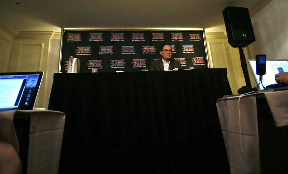 Photo - Big 12 Commissioner Dan Beebe listens to a reporters question during a news conference following Big 12 Conference meetings Friday, June 4, 2010, in Kansas City, Mo. (AP Photo/Orlin Wagner) ORG XMIT: MOOW104