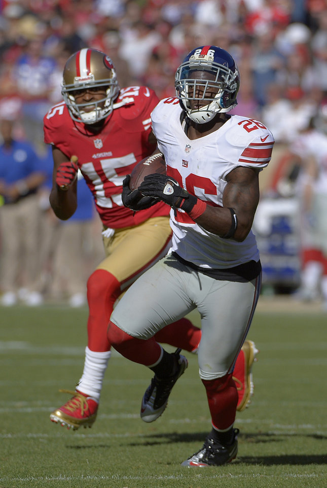 Photo -   New York Giants free safety Antrel Rolle (26) returns an interception as wide receiver Michael Crabtree (15) chases during the third quarter of an NFL football game in San Francisco, Sunday, Oct. 14, 2012. (AP Photo/Mark J. Terrill)