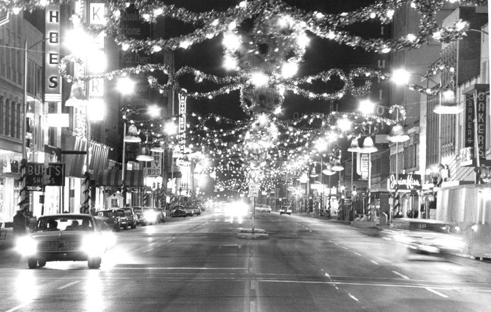 This 1964 photo of Oklahoma City's Main Street, decorated for Christmas, prompted Barbara Campbell to call The Oklahoman and  reminisce about her husband working with these lights every holiday season for years. OKLAHOMAN ARCHIVE photo