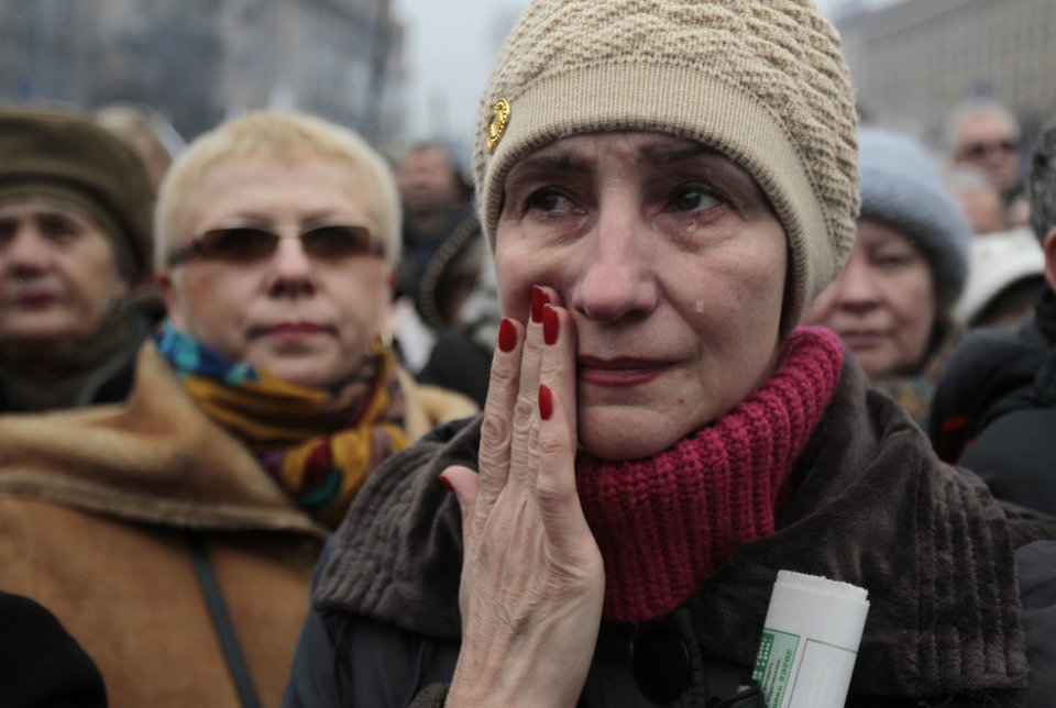 Photo - A woman reacts, during a rally in Kiev's Independence Square, Sunday, March 2, 2014. Ukraine's new prime minister urged Russian President Vladimir Putin to pull back his military Sunday in the conflict between the two countries, warning that