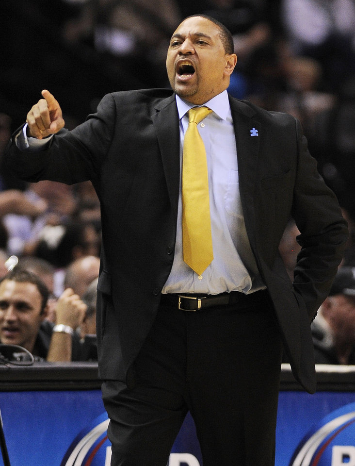 Photo - Golden State Warriors head coach Mark Jackson yells to his players during the second half of an NBA basketball game against the San Antonio Spurs on Wednesday, April 2, 2014, in San Antonio. San Antonio won 111-90. (AP Photo/Darren Abate)