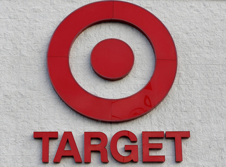 Photo - FILE - This Dec. 19, 2013, file photo shows a Target retail chain logo on the exterior of a Target store in Watertown, Mass. A massive data breach at Target Corp. that exposed tens of millions of credit card numbers has focused attention on a patchwork of state consumer notification laws and renewed a push for a single national standard. (AP Photo/Steven Senne, File)
