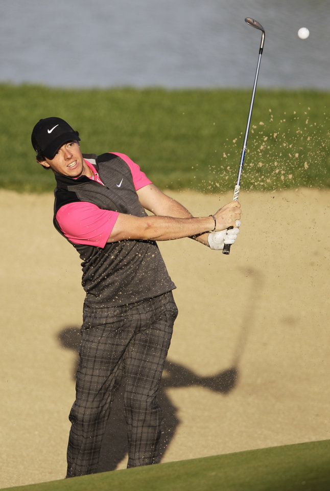 Photo - Rory McIlroy from Northern Ireland plays a bunker shot on the 13th hole during the first round of Abu Dhabi Golf Championship in Abu Dhabi, United Arab Emirates, Thursday, Jan. 17, 2013. (AP Photo/Kamran Jebreili)