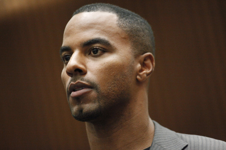 Photo - Former NFL safety Darren Sharper appears in Los Angles Superior Court, where he pleaded not guilty to charges of drugging and raping two women, Thursday, Feb. 20, 2014, in Los Angeles. Sharper's bail has been increased from $200,000 to $1 million. (AP Photo/Los Angeles Times, Bob Chamberlin, Pool)
