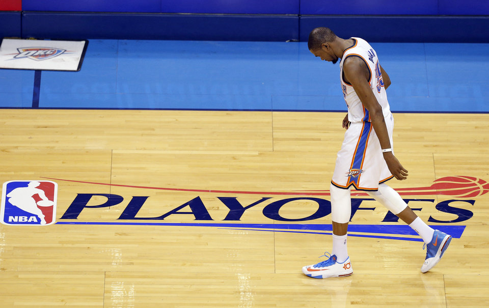 Photo - Oklahoma City's Kevin Durant (35) walks across the court in the fourth quarter during Game 1 of the Western Conference semifinals in the NBA playoffs between the Oklahoma City Thunder and the Los Angeles Clippers at Chesapeake Energy Arena in Oklahoma City, Monday, May 5, 2014. Photo by Bryan Terry, The Oklahoman