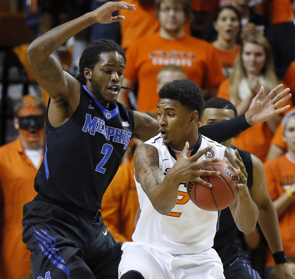 Photo - Oklahoma State's Le'Bryan Nash (2) tries to get past Memphis' Shaq Goodwin (2) during an NCAA college basketball game between Oklahoma State and Memphis at Gallagher-Iba Arena in Stillwater, Okla., Tuesday, Nov. 19, 2013. Photo by Bryan Terry, The Oklahoman