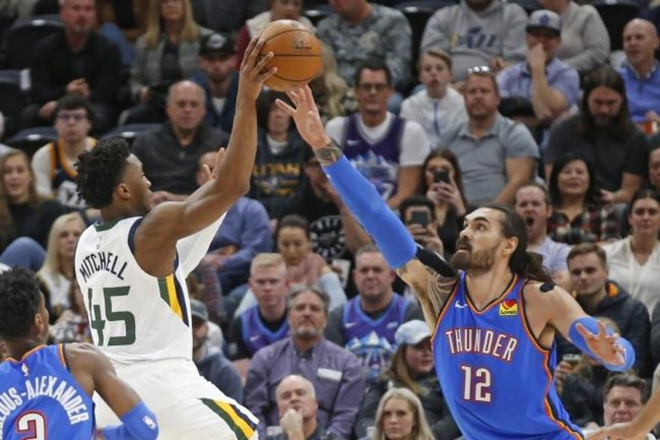 Photo -  Oklahoma City Thunder center Steven Adams (12) defends against6 Utah Jazz guard Donovan Mitchell (45) in the first half of an NBA basketball game Monday, Dec. 9, 2019, in Salt Lake City. (AP Photo/Rick Bowmer)