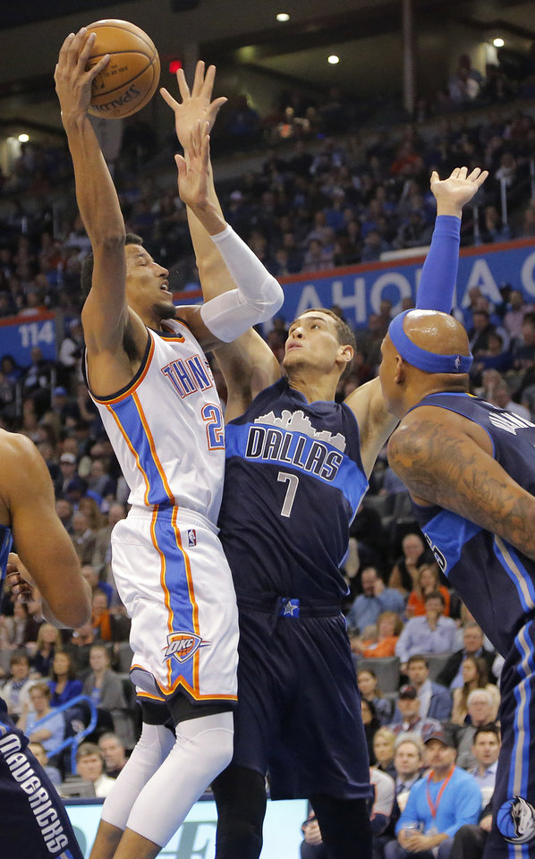 Photo - Oklahoma City's Andre Roberson (21) puts up a shot over Dallas' Dwight Powell (7) during the NBA basketball game between the Oklahoma City Thunder and the Dallas Mavericks at Chesapeake Energy Arena on Wednesday, Jan. 13, 2016, in Oklahoma City, Okla.  Photo by Chris Landsberger, The Oklahoman
