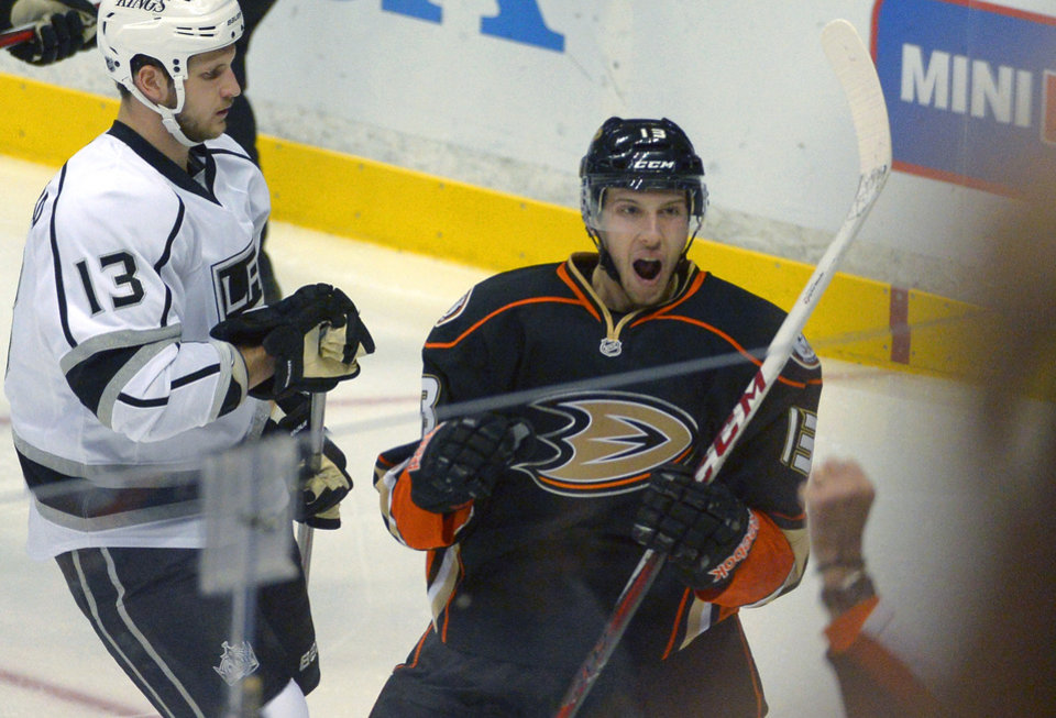 Anaheim Ducks center Nick Bonino, right, celebrates his goal as Los Angeles Kings left wing Kyle Clifford watches during the first period of their NHL hockey game, Saturday, Feb. 2, 2013, in Anaheim, Calif. (AP Photo/Mark J. Terrill)